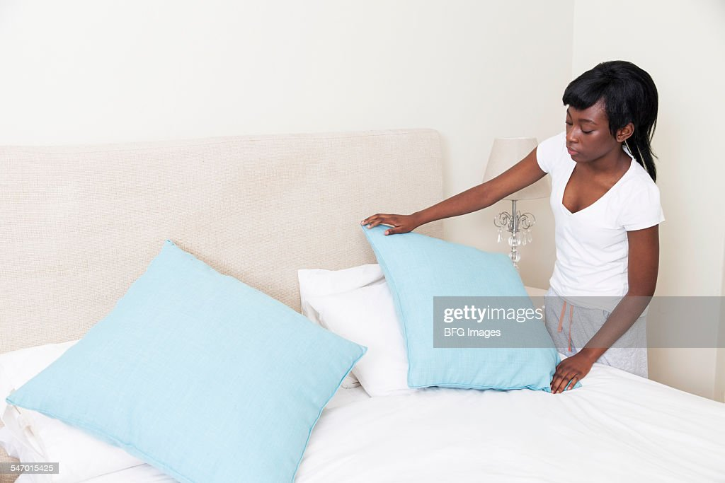 girl making bed