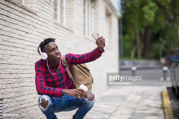 african teenager making a self portrait. - nigerian men stock photos and pictures
