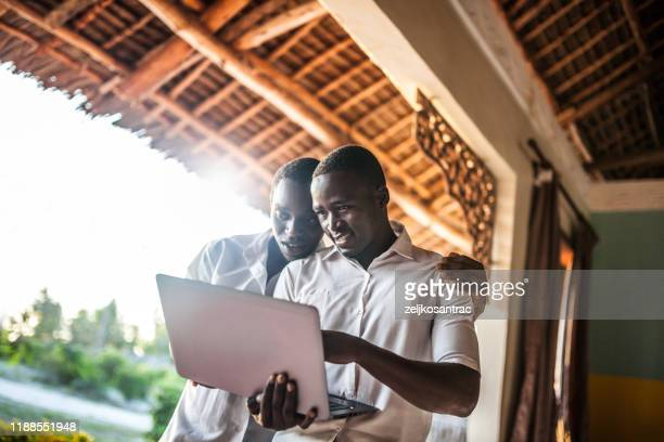 african teenager  using a laptop - africa stock pictures, royalty-free photos & images