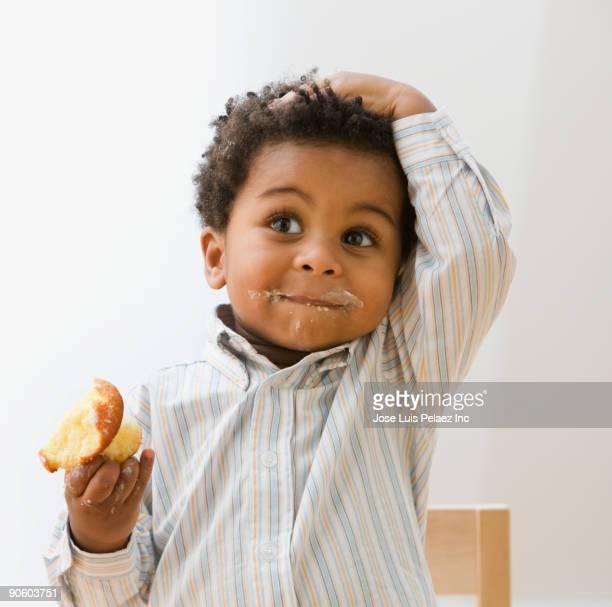 African toddler eating cupcake