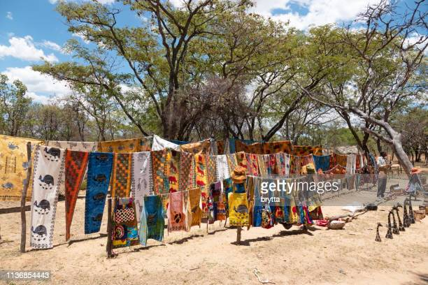 african traditional textile and souvenirs for sale on a street market stall , matopos national park,zimbabwe - zimbabwe stock pictures, royalty-free photos & images