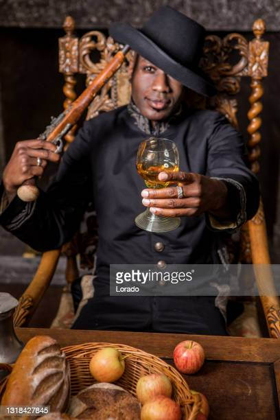 african traditionally dressed european man with a weapon - black history in the uk stock pictures, royalty-free photos & images