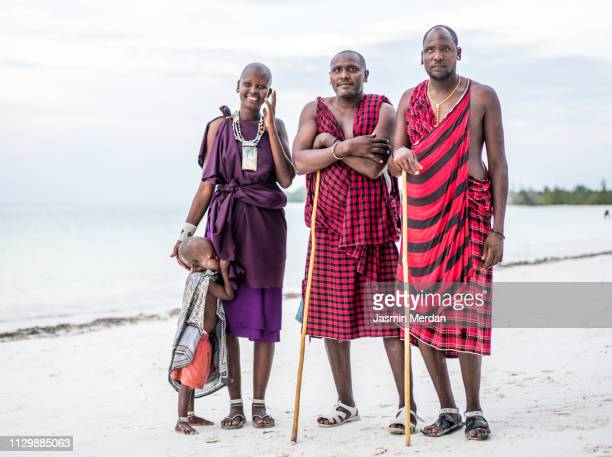 african tribe family on beach - african tribal culture stock pictures, royalty-free photos & images