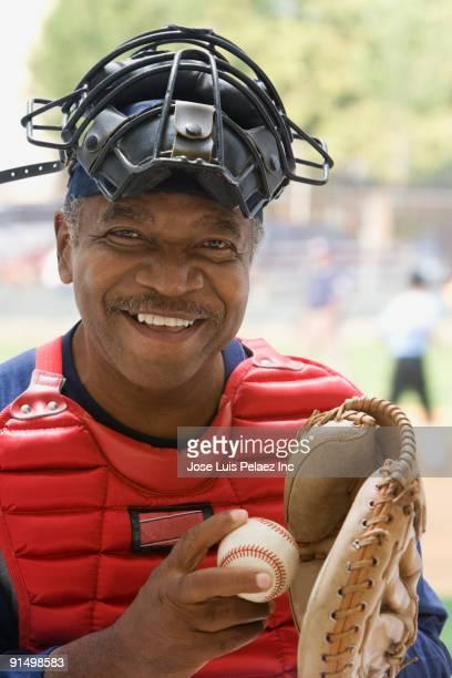 african umpire smiling - キャッチャーミット ストックフォトと画像