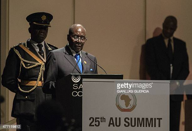 African Union chairperson and Zimbabwean President Robert Mugabe addresses the opening session at the 25th African Union Summit in Sandton...