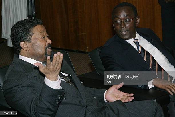 African Union chairperson Jean Ping speaks with Prime Minister of Rwanda Makuza Bernard during the African Union Peace and Security Council meeting...
