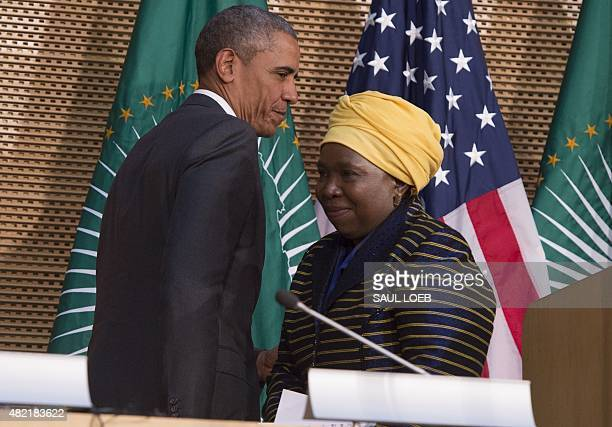 African Union Chairperson Nkosazana Dlamini Zuma leaves the stage as US President Barack Obama arrives to deliver a speech at the African Union...