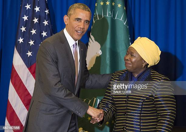 African Union Chairperson Nkosazana Dlamini Zuma shakes hands with US President Barack Obama during a meeting at the African Union Headquarters in...