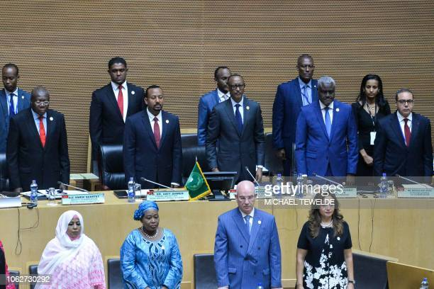 African Union Chairperson Rwandan President Paul Kagame flanked by Ethiopia Prime Minister Abiy Ahmed and Africa Union Commission Chairperson Moussa...