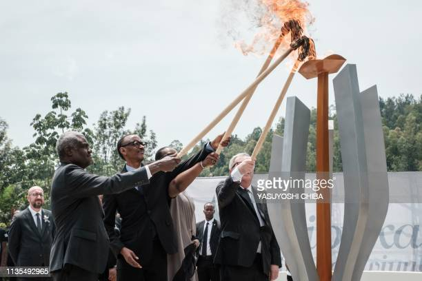 TOPSHOT African Union chief Moussa Faki Rwanda's President Paul Kagame his wife Jeannette and European Commission President JeanClaude Juncker light...