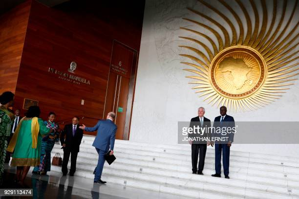 African Union Commission Chairman Moussa Faki of Chad and US Secretary of State Rex Tillerson stand for news photographers after their meeting at AU...