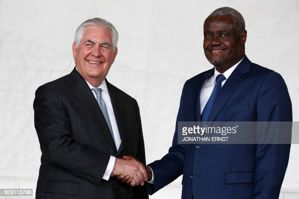 African Union Commission Chairman Moussa Faki of Chad and US Secretary of State Rex Tillerson shake hands after their meeting at AU headquarters in...