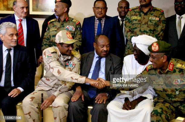 African union envoy to Sudan Mohamed al-Hacen Lebatt sits next to Sudan's deputy chief of the ruling military council General Mohamed Hamdan Dagalo...