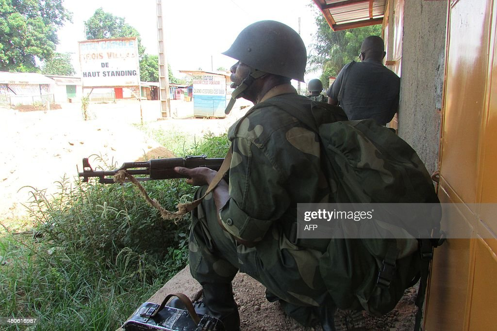 African Union intervention force (MISCA) secure the area during an operation to free the way leading to the north of Bangui on March 25, 2014. At least 15 people have been killed in the Central African Republic capital of Bangui since Saturday as a result of clashes involving armed groups and foreign peacekeepers, officials and residents said Tuesday.