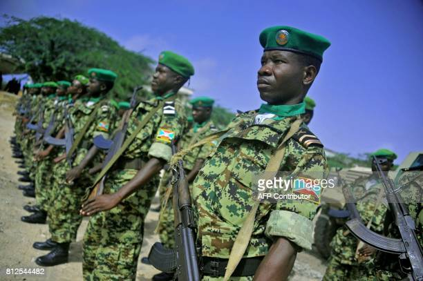 African Union soldiers from Burundi stand to attention in Mogadishu on July 11 2017 A contingent of Burundian soldiers stationed in Somalia under...