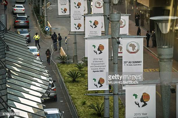 African Union Summit banners are pictured outside the Sandton Convention Centre during the 25th African Union Summit on June 12 2015 in Johannesburg...