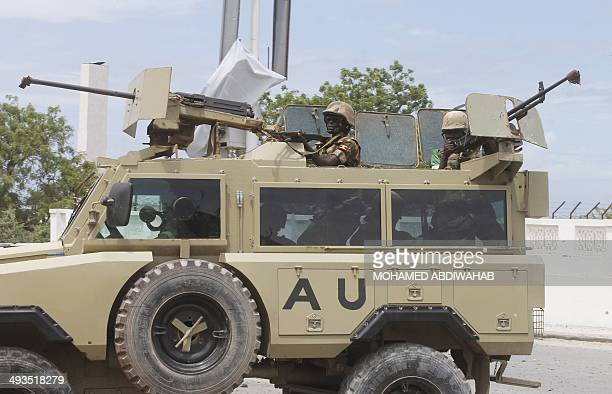 African Union troops arrive in an armoured vehicle during an attack on the Somali parliament in Mogadishu on May 24 2014 Somalia's Shebab rebels...