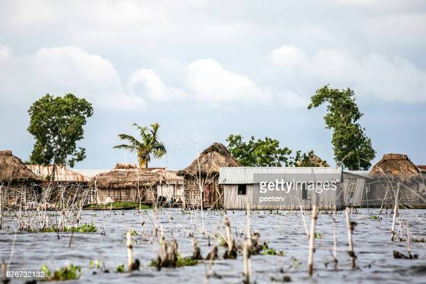 african village on the water. ganvie, benin. - dugout canoe stock photos and pictures