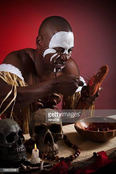 african witch doctor with voodoo doll - voodoo doll stock photos and pictures