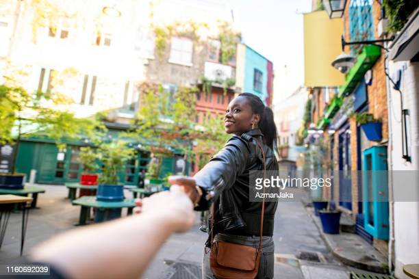 african woman and her boyfriend exploring london - things that go together stock pictures, royalty-free photos & images