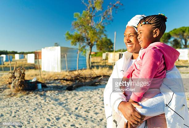 african woman and her daughter at sunrise - xhosa culture stock photos and pictures