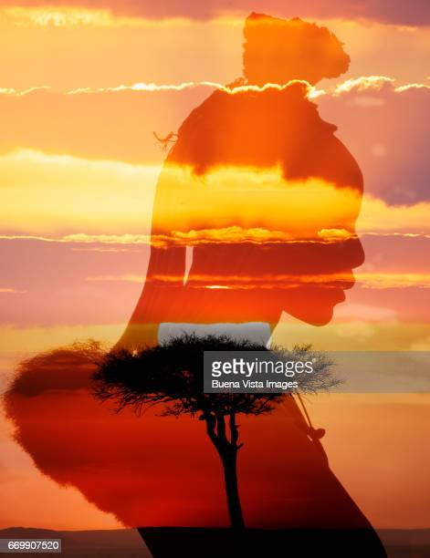 african woman at sunset - himba stock-fotos und bilder