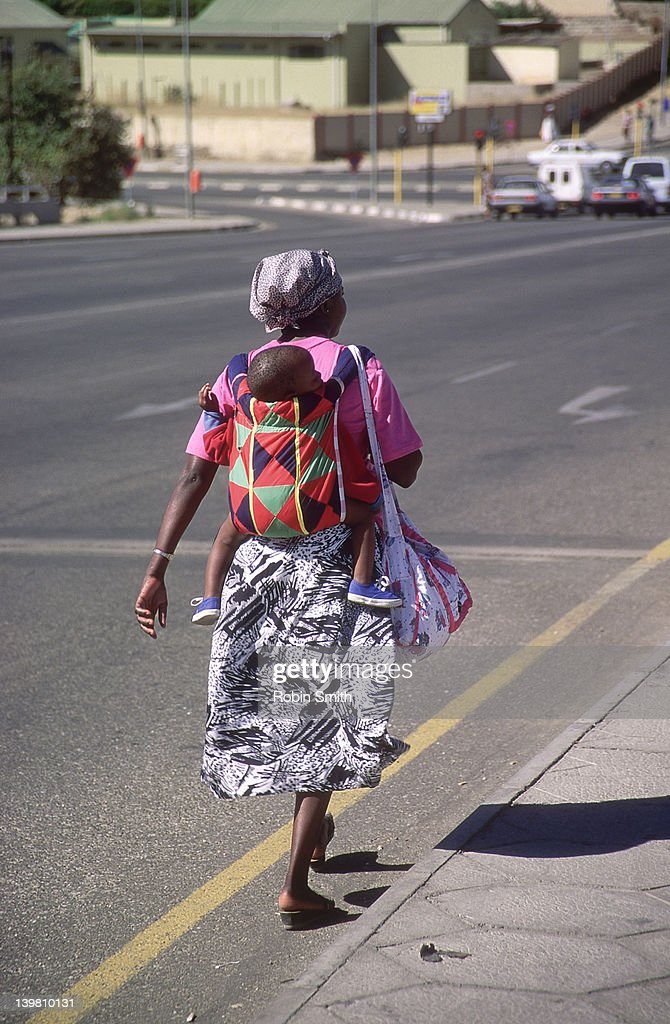 African Woman Carrying Baby On Back Windhoeck Namibia Stock