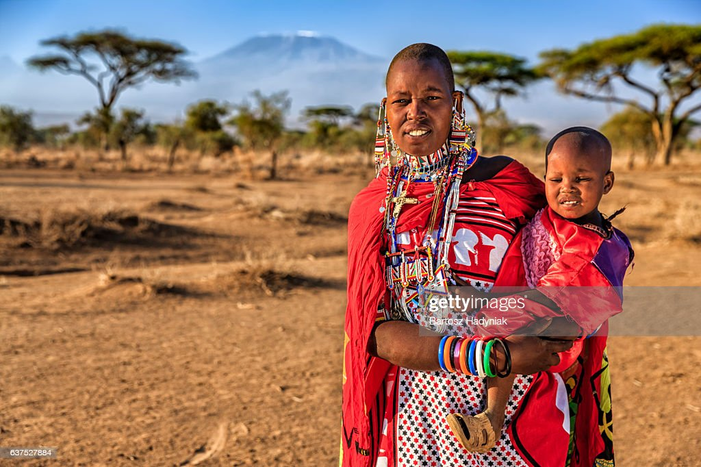 African woman carrying her baby, Kenya, East Africa : Stock Photo