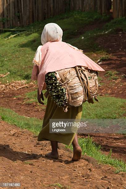 African woman carrying on her back