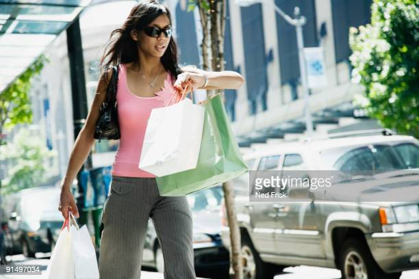 African woman carrying shopping bags