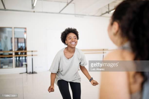 african woman dancing at fitness club - darstellender künstler stock-fotos und bilder