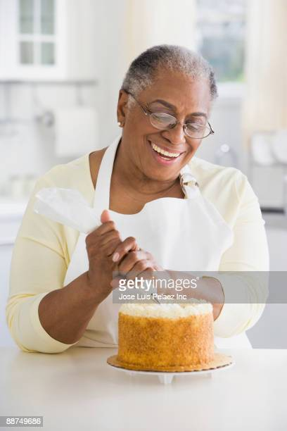 African woman decorating cake