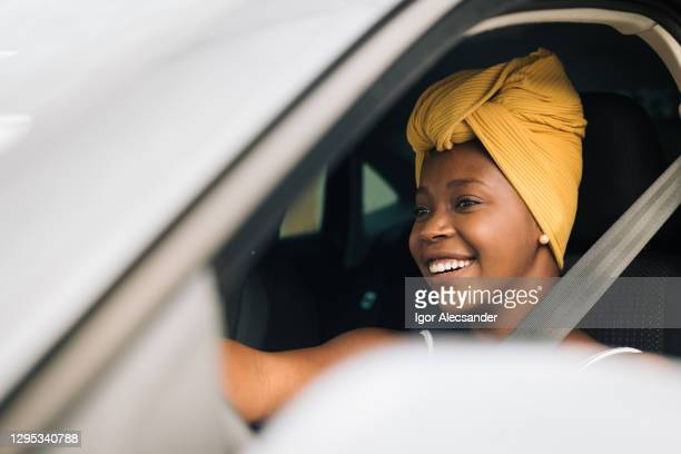 african woman driving a car - driving stock pictures, royalty-free photos & images