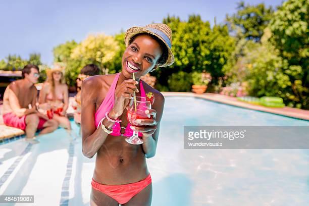 African woman enjoying cocktail