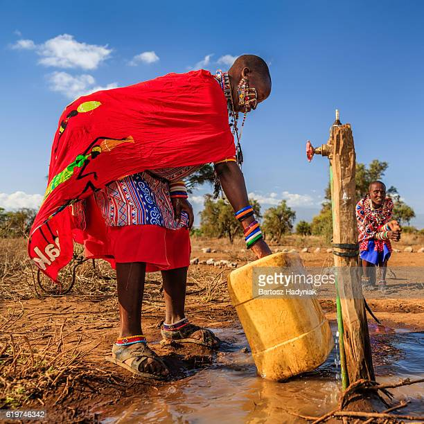 African woman from Maasai tribe collecting water, Kenya, East Africa