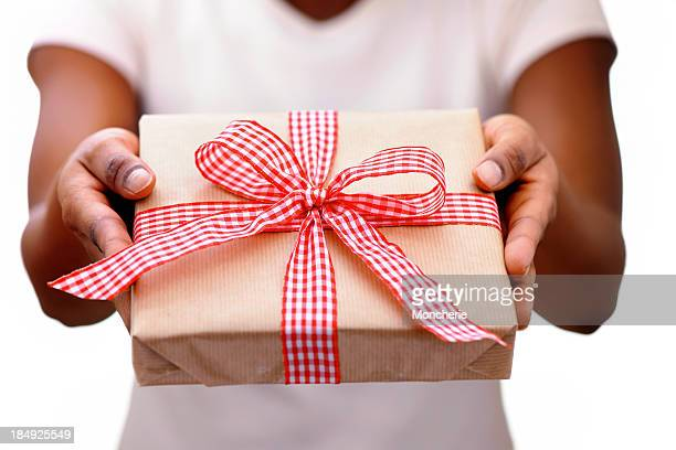 African woman giving a christmas present
