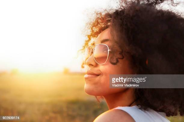 african woman having fun - sunny stock pictures, royalty-free photos & images