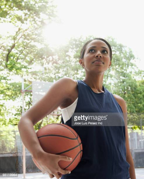 African woman holding basketball