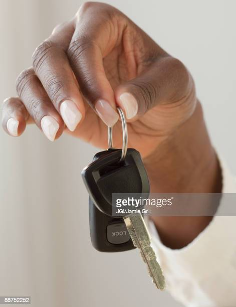African woman holding car keys