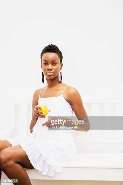 African woman holding orange juice