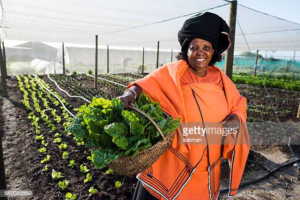 African Woman holding vegetables