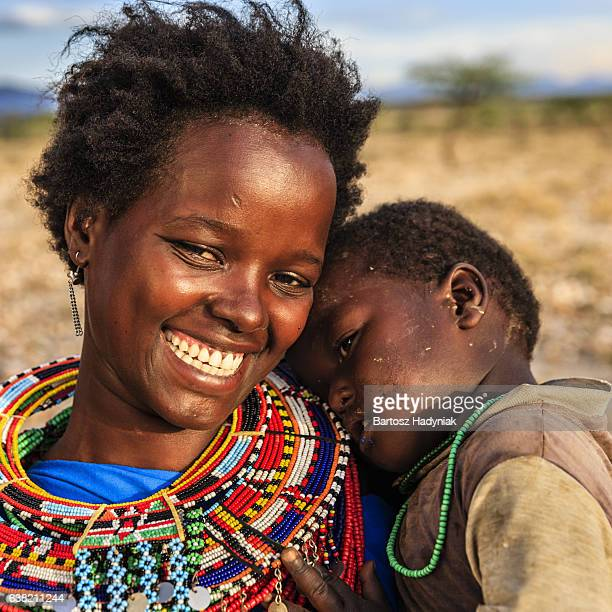 african woman hugging her baby, kenya, east africa - african tribal culture stock pictures, royalty-free photos & images