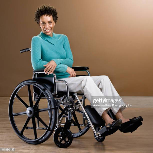 african woman in wheelchair - paraplegic stock photos and pictures