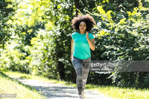 African woman jogging in park