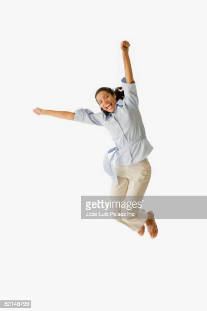 African woman jumping in air