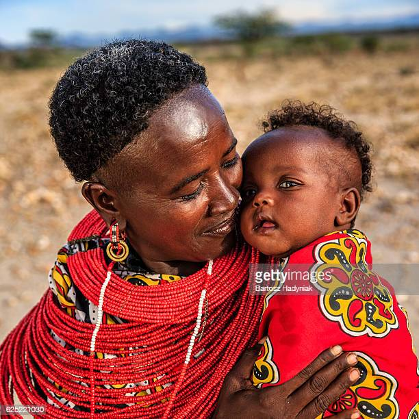 african woman kissing her baby, kenya, east africa - african tribal culture stock pictures, royalty-free photos & images