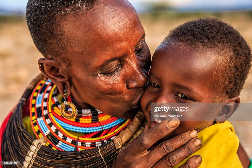 African woman kissing her baby, Kenya, East Africa : Stock Photo