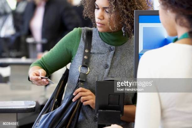 african woman looking at credit card - black purse stock pictures, royalty-free photos & images