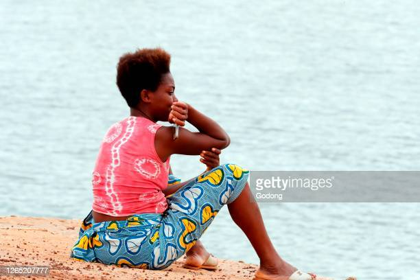 African woman looking at the sea. Aneho. Togo.