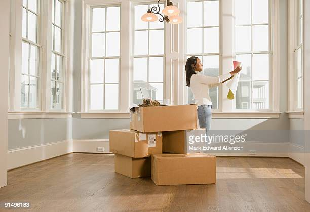 African woman moving house